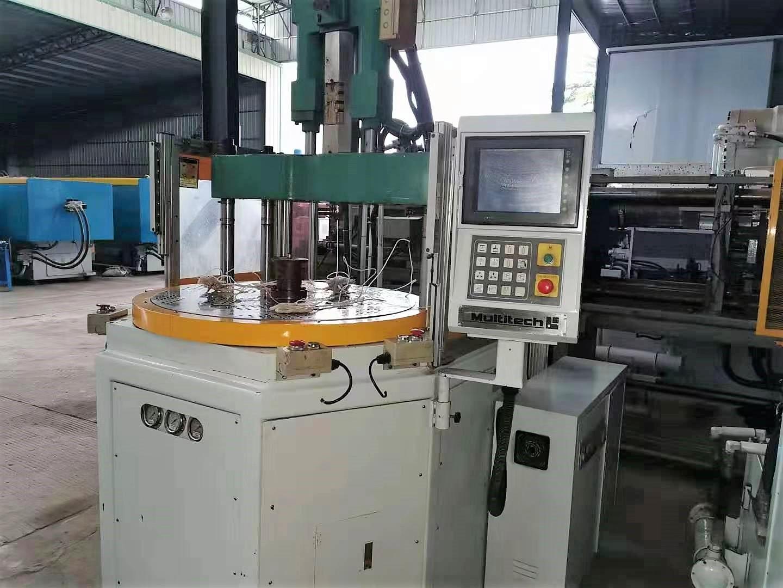 Taiwan Ultitech 55t (tafole e potolohileng) e sebelisitse setšoantšo sa mochini oa Vertical Injection Merting Machine
